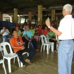 Mayor Leoncio Boy Evasco, Jr. discusses programs and projects designed to strengthen the Maribojoc Market Vendors Association headed by president Rolando Locoy Ollamina.  (Photo by Fred Fuertes)