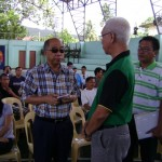 PROJECT STARS. Gov. Erico B. Aumentado stresses a point to Mayor Boy Evasco, Jr. during the opening program Wednesday of the Skills Training Advocating Reliance and Self-Employment (STARS) Project at the Maribojoc Cultural and Sports Center.  Senior municipal councilor Jun 'Tusoy' Redulla, Jr. listens attentively.