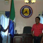 Vice-mayor Fructuoso F. Redulla, Jr. witnesses the turn-over ceremony between outgoing PNP Chief PSInsp. Sayon and incoming PNP Chief Police Inspector Enreque Kilnet Asonio.